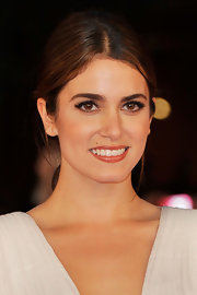 Nikki Reed wore flirty and feminine false lashes and a hint of shimmering shadow at the premiere of 'Breaking Dawn.'