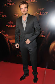 Robert Pattinson looked suave in a charcoal suit over a soft gray button-up for the 'Twighlight Saga: Breaking Dawn Part 2' Paris premiere.