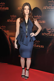 Ashley Greene topped off her navy blue ensemble with classic black strappy sandals.