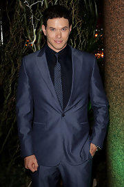Kellan looked daper in a navy suit with a striped, narrow tie.