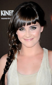Lucia wore a side-braided hairstyle with cool angled bangs.