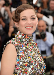 Marion Cotillard was uniquely coiffed with this finger wave-inspired updo at the 'Two Days, One Night' photocall.