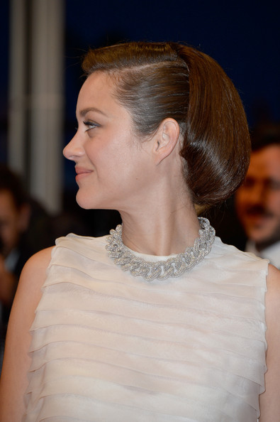 Marion Cotillard accessorized with a statement diamond choker necklace by Chopard for the premiere of 'Two Days, One Night' at the 67th Annual Cannes Film Festival.