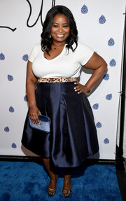 Octavia Spencer styled her outfit with a pair of leopard-print ankle-strap sandals.
