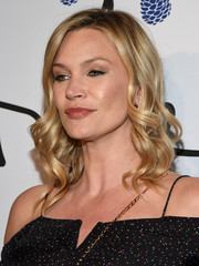 Natasha Henstridge wore her hair in perfectly styled curls at the Tyler Ellis 5th anniversary celebration.