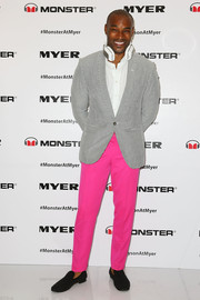 Tyson Beckford kept it tame from the waist up in a gray pinstripe blazer layered over a white button-down.