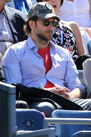 Bradley wore a camouflage baseball cap at the U.S. Open tennis match.
