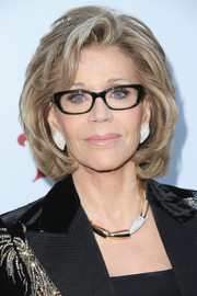 Jane Fonda dressed up her look with a gold and diamond collar necklace and matching earrings.