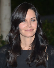 Courteney Cox kept her beauty look basic with nude-colored, natural lips.