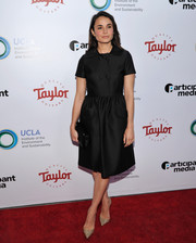 Mia Maestro polished off her look with gold glitter pumps.