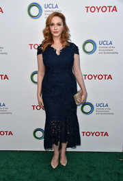 Christina Hendricks sheathed her curves in a navy lace dress by Shoshanna for the Innovators for a Healthy Planet event.