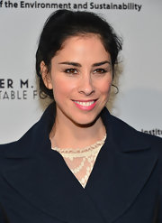 Sarah Silverman tied back her black locks into a ponytail for a casual red carpet look.