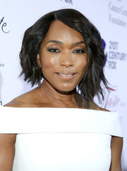 Angela Bassett went for a trendy asymmetrical cut when she attended the Taste for a Cure event.