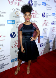 Yara Shahidi topped off her dress with a purple cardigan.