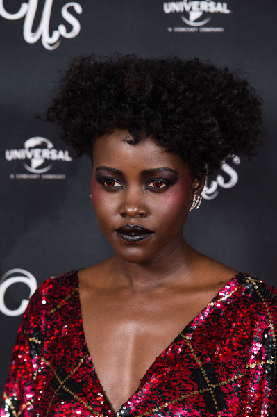 Lupita Nyong'o wore her hair in a nest of curls at the UK exclusive screening of 'Us.'