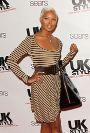 Eva wore a striped dress with an over-sized belt to the UK Style launch.