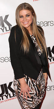 Carmen Electra wore her hair straight and sleek at the UK Style event. A center part completed her polished look.
