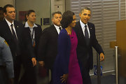 Michelle looked elegant in a draped fuchsia dress and long purple cardigan coat for the UN General Assembly in NY.