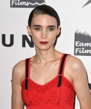 Rooney Mara swiped on some bold red lipstick to match her outfit.
