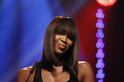 Naomi Campbell wore her shoulder length bob super sleek and straight with sexy lash-grazing bangs at the 2011 UNESCO Charity Gala.