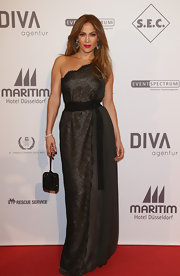 Jennifer Lopez oozed elegance in this silky lace gown at the UNESCO Charity Gala.