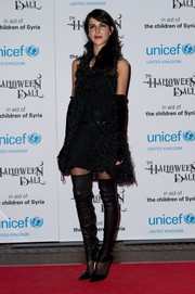A pair of black leather thigh-high leg warmers by Chanel added a rocker edge to Caroline Sieber's look.