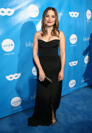 Sophia Bush complemented her dress with an embellished black box clutch.
