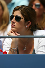 Mirka Federer kept it classic with aviator sunglasses that hid the sun but not her style.