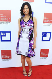 Wendi Deng matched her floral dress with a pair of crisscross strapped sandals.