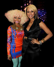 Nicki wore a printed little Versace dress with bright blue tights and heavy jewelry.