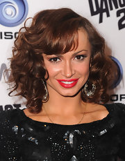 Karina added extra volume to her look with a heap of curls.