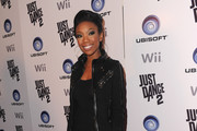 Singer Brandy arrives to the launch party for Ubisoft's