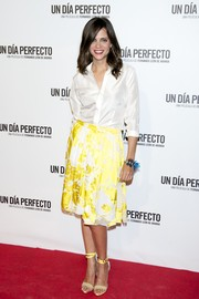 Macarena Gomez styled her shirt with a summer-chic floral skirt.
