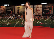 Madalina Ghenea posed at the 'Un Ete Brulant' premiere wearing a one-shoulder sequined dress with fringe detailing.
