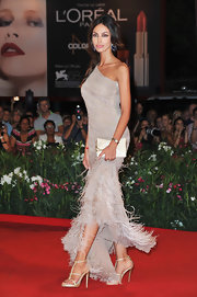 Madalina Ghenea teamed up her extravagant dress with a subtle pair of platform sandals at the Venice Film Fest.