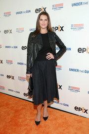 Brooke Shields attended the New York premiere of 'Under the Gun' sporting an all-black skirt, tee, and leather jacket ensemble.