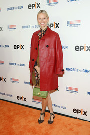 Karolina Kurkova kept warm with a red leather coat as she arrived for the New York premiere of 'Under the Gun.'