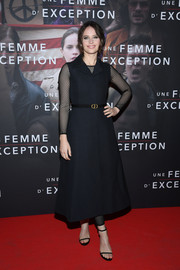 Felicity Jones looked effortlessly chic in a sleeveless black coat dress layered over a mesh catsuit at the Paris premiere of 'On the Basis of Sex.'