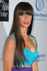 Leona Lewis added a splash of color to her color blocked look with a vibrant pink pout.