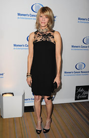 Kate wore this little black dress with a lace neckline to the Women's Cancer Research benefit.
