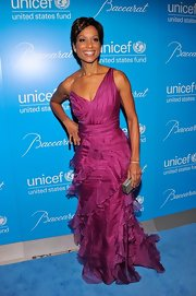 Sade looked lovely in this ruffled fuchsia gown at the UNICEF Snowflake Ball.