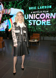 Brie Larson matched her jacket with a studded leather skirt, also by Rodarte.
