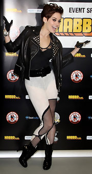 Pussycatdoll Kimberly showed off her dancing skills at the United Dance photocall. She showed up wearing some sort of pants or skirt and paired it with a studded leather jacket. She topped her look off with patent leather ankle boots.