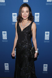 Michelle Yeoh matched an embellished black frame clutch with a beaded gown for the UNDP Inaugural Global Goals Gala.