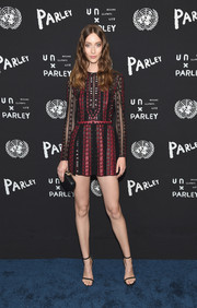 Alana Zimmer showed off her supermodel legs in a red and black mini dress during the United Nations x Parley for the Oceans launch.