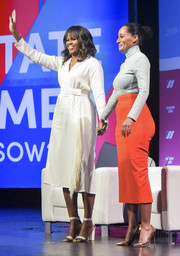 Michelle Obama complemented her dress with a pair of white ankle-strap heels.