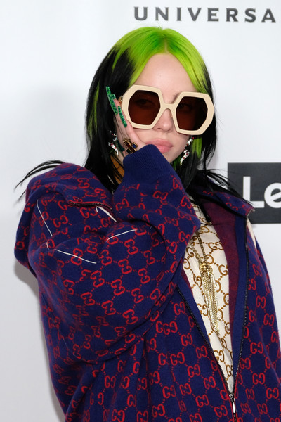 Billie Eilish accessorized with a pair of oversized geometric shades by Gucci at the Universal Music Group Grammy after-party.