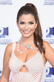 Ana Patricia Gonzalez paired her sexy cocktail dress with a statement beaded necklace.