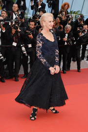 Helen Mirren kept it timeless in a blue and black lace dress at the Cannes premiere of 'The Unknown Girl.'