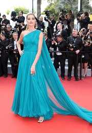 Ana Beatriz Barros looked downright divine at the Cannes premiere of 'The Unknown Girl' in an aqua-blue Ralph & Russo one-shoulder gown with a flowing train.